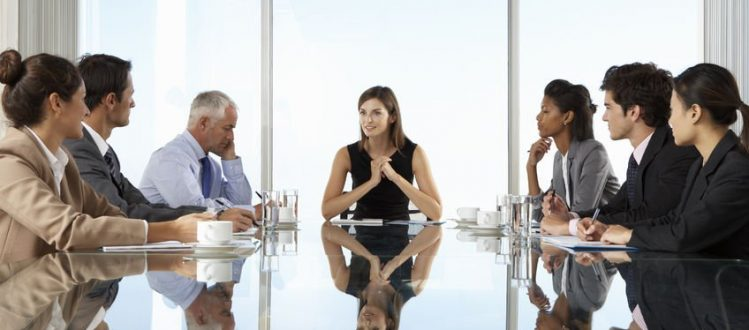 business woman leading boardroom meeting