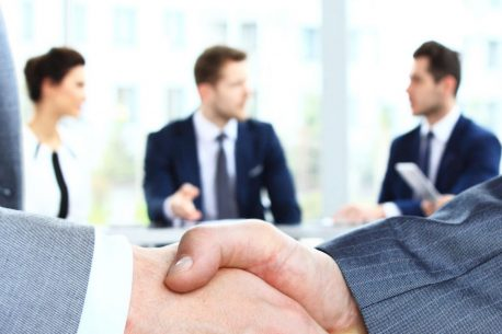businessmen handshaking hands