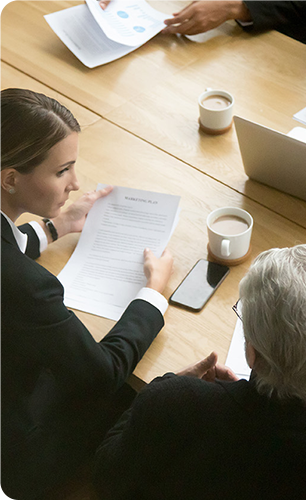 woman reviewing contract in meeting