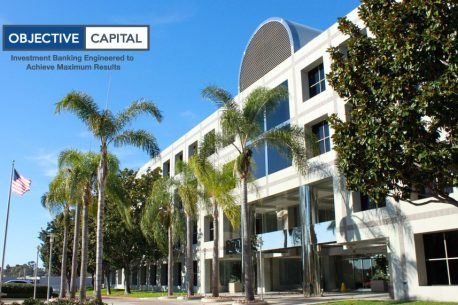 building with palm trees and ocp logo