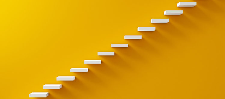 stairs along a yellow wall